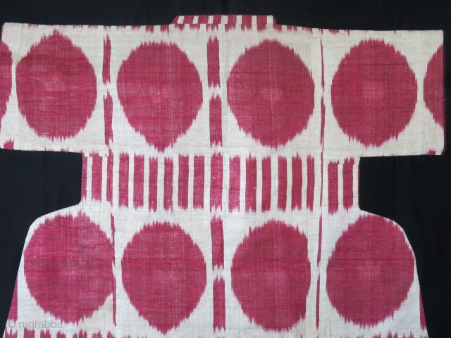 "Uzbek adras Ikat Chapan fragment, mounted on black cotton. Size: Arm to arm 33"" - 36"" height -  84 cm X 92 cm"