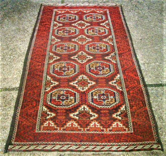 Antique Baluch rug. Size: 107 x 208 cm. With Camel-Wool. One small repair. One small area with thin pile.