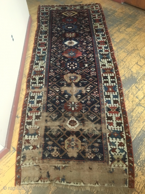 Antique long rug, possibly northwest Persian. Good quality rug in somewhat abused condition. Interesting field design and well drawn large scale  crab border. All natural colors. Large areas of wear, few  ...