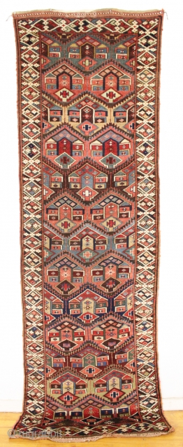 antique kurdish palmette long rug in excellent original condition with no repairs. Beautiful field design paired with an interesting border. All natural colors including some pretty camel wool pile. Washed, but otherwise  ...