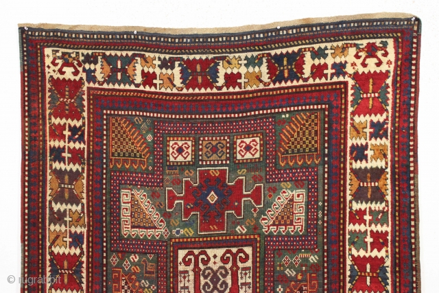 early large kazak rug with real green ground and an exceptionally colorful border. All splendid natural colors featuring beautiful greens, excellent reds, a nice aubergine and clear yellow/gold highlights. The extra attention  ...
