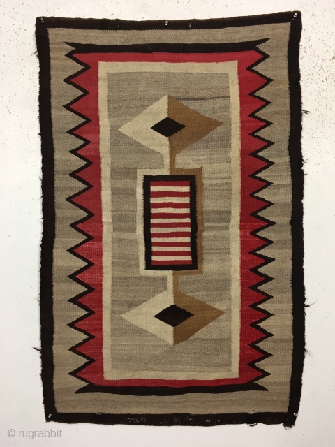 Antique small Navajo rug with a very eye catching design. Fresh New England find. Beautiful colors and soft blanket like handle. In reasonably good condition with some slight selvage roughness and a  ...