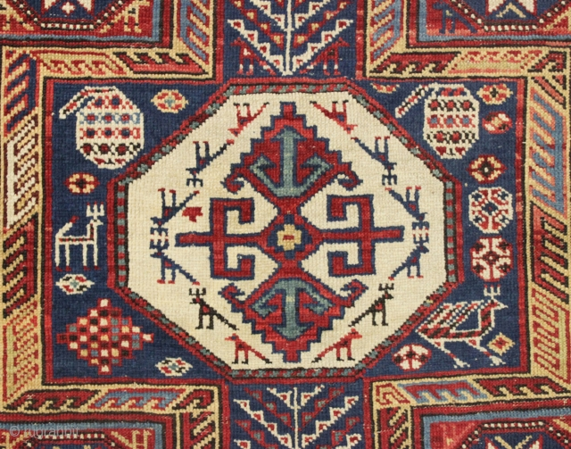 antique caucasian rug, probably shirvan, in pretty good condition with extra long keyhole style medallion and many charming animals. Overall fair even pile with good edges and ends. All good saturated natural  ...