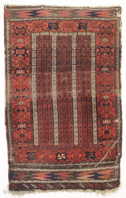 antique baluch rug with an interesting and unusual design. Another piece from a local Boston home. Charming cane design field and an attractive unusual border. All natural colors. In fair condition. Even  ...