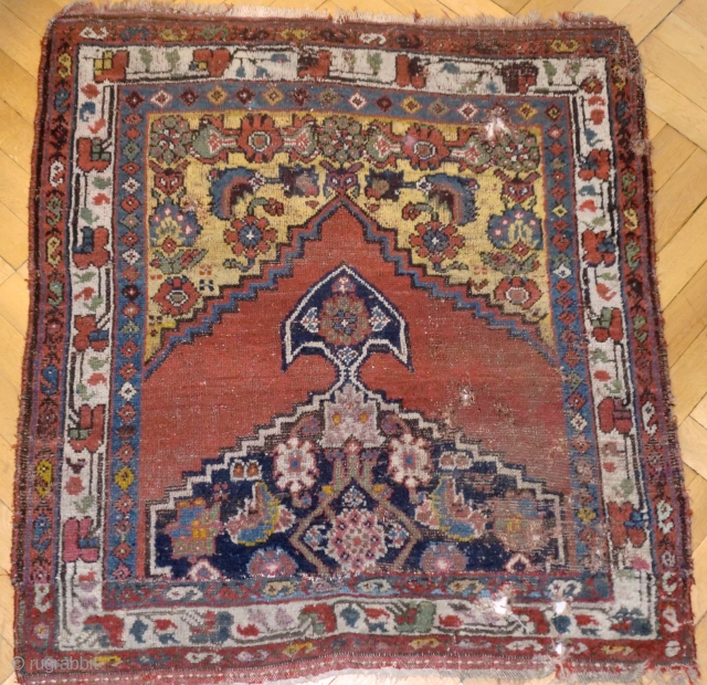 Anatolian or N/W tribal fragment. 125/106 cm. 19th C. Half of the original rug resides already in eternity and the remaining part did not survive undamaged.However the upper side deserves our attention because  ...
