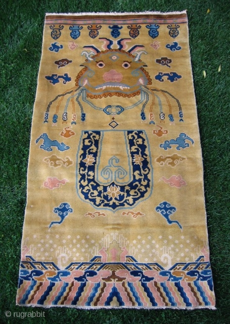 """Chinese hanging/banner rug (3' 11"""" x 7' 4""""); unusual t'ao-t'ieh mask design on pale gold field, full pile lustrous wool and in excellent condition; 20th century"""