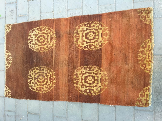 #1714 Tibet rug, brown background with golden yellow group flowers, wool warp and weft, good age and quality.size153*83cm(60*32'')