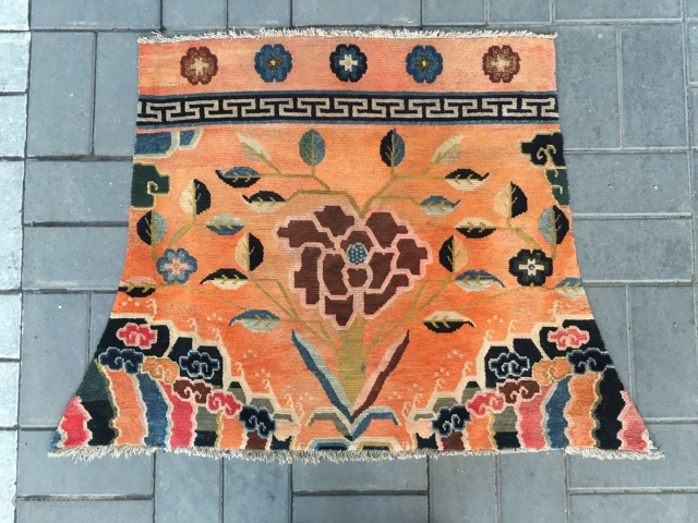 #2052 Tibet saddle rug, orange background with a peony flower with lucky clouds around. The water beads spurted out from the sea water and cliffs are very beautiful. Good age and quality.  ...