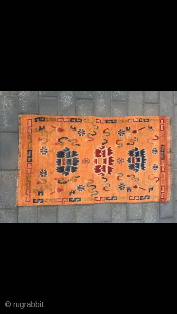 "Tibetan rug, orange color with Buddha eight treasures pattern. Wool warp and weft. Size 145*73cm(56*28"")"