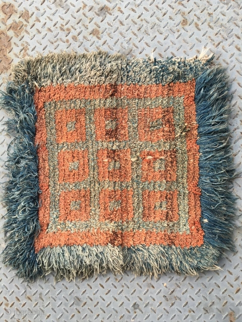 #2009 Tibet Wangden rug. Red square checker with blue wool selvage.