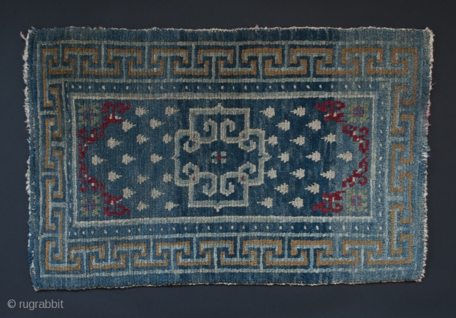 """Small wool rug, Tibet. 22"""" (56 cm) by 35"""" (89 cm). Please note: the second images of the full rug and the detail are photos of the back of the rug. They look  ..."""