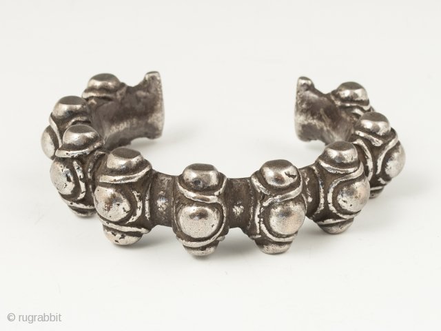 "Silver warrior's bracelet, Atoni people, West Timor. 6.5"" (16.5 cm) interior circumference, 1.25"" (3.1 cm) opening. Early 20th century, 186 grams. Ex. Anthony Granucci collection."