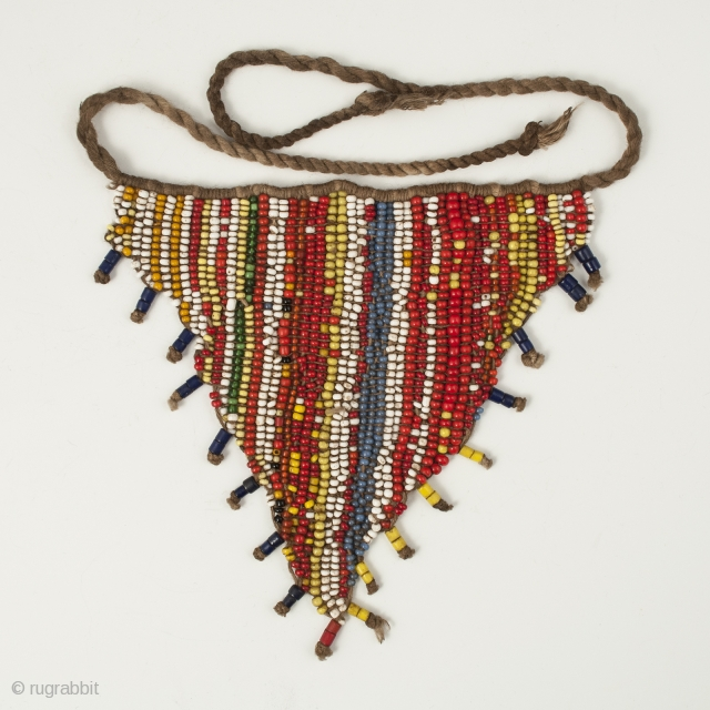 "Pikuran (cache-sexe), Bana Guili people, Mandara Mountains, Cameroon. Seed beads, cotton string, 5"" (12.7 cm) wide by 4.75"" (12 cm) high. Mid 20th century. These were worn by young girls during ceremonies,  ..."