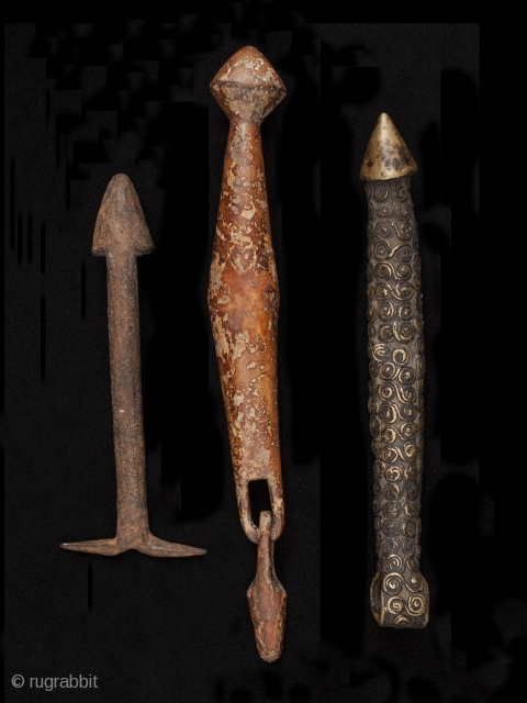 """Phallus amulets, Burkina Faso. Iron, wood, bronze 6"""" (15.2 cm), 9"""" (23 cm) and 7.25"""" (18.4 cm) high. Mid 20th century  These are either amulets of fertility or an indication of male prowess."""