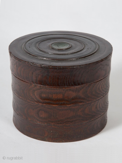 """Small box, Korea. Zelkova (elm) wood, green paint, 4.25"""" 10.8 cm) high, 5.5"""" (14 cm) diameter. Late 19th to early 20th century. This unique, beautifully grained box has been carved as if there were three separate tiers  ..."""