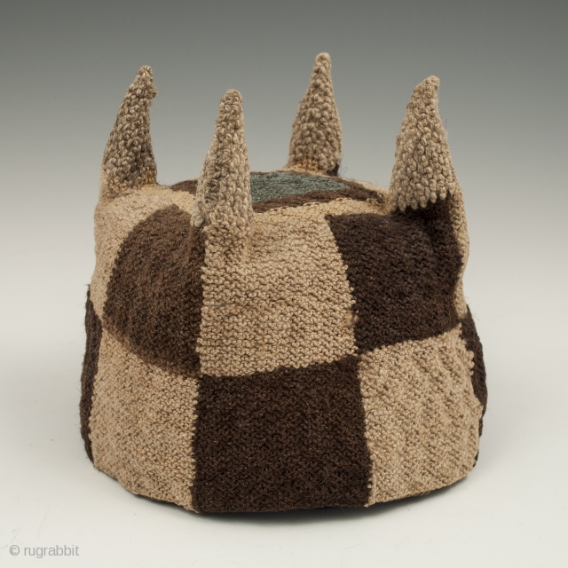 Four-cornered hat, Huari culture, Peru. Camelid fibers, natural dye.