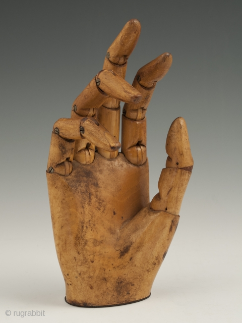 """An expressive articulated carved wood mannequin hand, likely made in France. It measures 7"""" (17.7 cm) high by 3"""" (7.6 cm) wide. Late 19th to early 20th century."""