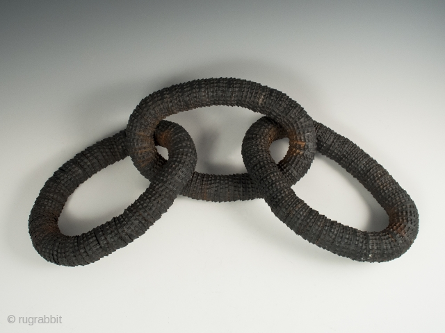 """Odd Fellows triple links, Indiana. Made of strung bottle caps, each link is 8"""" (20.3 cm) long with overall length of 19"""" (48.2 cm), Early 20th century, Ex. Thomas and Audrey Metzger  ..."""