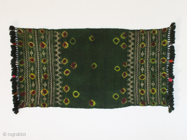"Ketfiya, Southern mountain region of Tunisia. 35""(89 cm) long (without fringe) by 17"" (43.1 cm) wide. Late 20th century. Worn around the shoulders to protect a woman's dress from the oil in  ..."