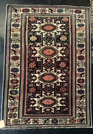 """Antique Hand-Woven Caucasian Lesghi Azeri Rug  Antique Caucasian Azeri rug, hand-woven, all wool with Lesghi-styled pointed star medallions in navy blue and red tones against cream ground.   late 19th century   Dimensions: 2' 10""""  ..."""