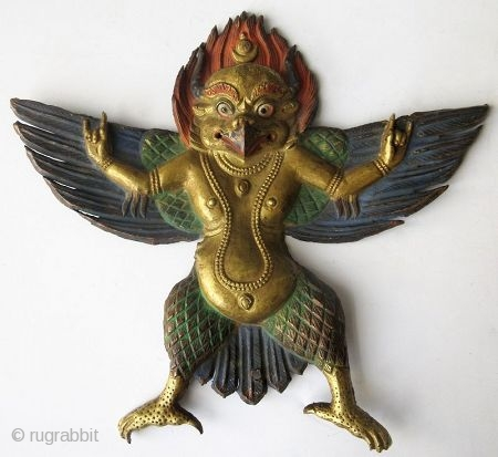 Tibetan Gilt Copper Repousse Figure of Garuda   A gilt copper repousse figure of Garuda, finely worked with outstretched wings, his hands in the Karan mudra or demon-expelling mudra. He wears long necklaces hanging  ...