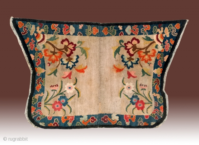 """No.DX089 * Chinese Tibetan Lady Saddle Rugs.Age: Early-20th Century.Size: 70 x 110cm (2'3""""x3'7"""").Origin: Tibet. Shape: Papilionaceous.Background Color: Off-whites,lvory. Flower design with stylized floating cloud motifs."""