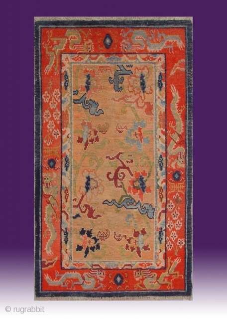 """No.X0010 * Tibetan Antique """"Dragons + Flowers"""" Rug . Origin: Tibet  Age: About 100 Years Old. Size: 84x141cm(33""""x56""""). Shape: Rectangle.Background Color: Orange. cotton/wool."""
