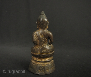 Fine heavily cast Buddha from Northern Thailand, Nan provincial style, late Chiang Saen period circa 17th CE. A sturdy little image with excellent patina, traces of original gilding and a determined expression.  ...