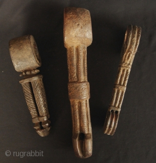 Ensemble of three Nepali butter churning stick holders from Nepali hill minorities. Nice worn patina, circa 60 to 90 years old, the one on the right appears to be older. No kitchen  ...