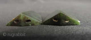 Pair of serpentine cicadas carved in the Warring States style, one has a chip on the corner, which may be seen in enlargements. These may be worn as pendants or incorporated into  ...