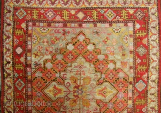 Xinjiang, China. Rug 2 Lively circa mid 20th century Khotan rug with two diamond shaped medallions and moon flower centers. Some minor repairs along the selvedge (see enlargements). A cheerful piece with  ...