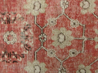 Khotan Rug: Xinjiang , sitting carpet with red field and moon flower vein pattern. Worn with lots of repair (see enlargements). L: 125cm/49in and W: 64cm/25in.
