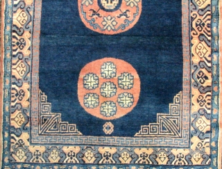 Xinjiang Chinese Rug    Fine Khotan carpet with three moon flower medallions, full pile, deep blue indigo field and subtle abrash, circa 1st half 20th century. Excellent soft pile and no damage (that I  ...