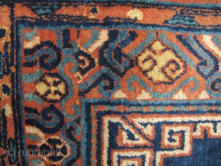 Khotan Carpet: Fine old Xinjiang aka Chinese Turkestan carpet with central medallion emulating Tibetan tie dyed P'ulo-thigma cloth and stylized Chinese auspicious symbols, circa early 20th century. A couple of corners have  ...
