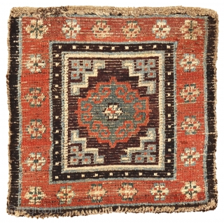Meditation mat with archaic Mandala, Tibet, circa 1850, 62 x 61 cm (24.5 x 24 inches) Tibetan rugs with thick squarish knots and a brilliant palette are considered among the earliest, often referred  ...