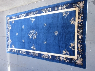 An antique Peking carpet in a very rare gallery format,with a mostly open luminous royal blue ground.The wool is glossy with a desirable patina.There is slight carving to further emphasize the design  ...