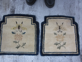 Two shaped Peking Chinese mats circa 1920's,each measuring 1.5 x 1.5.Charming mats with lush,unworn piles,with indented top corners.The creamy beige fields of each has a butterfly and paeony spray on an otherwise  ...