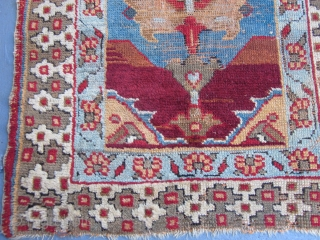 Possibly Northwest Persian or Eastern Turkish,Probably Kurdish,measuring 5.10 x 3.1,mid-19th century.Totally rustic and tribal,two huge palmettes set on a charming light blue field with rust and dark brown tones.The foundation is all  ...