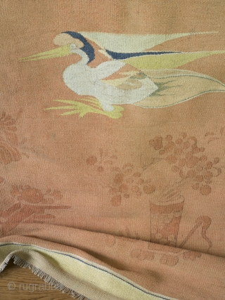 Antique Mongolian Gansu tapestry   The most beautiful and unusual double sided kilim tapestry. 276cm x 117cm.   Featuring woven Taoist cranes and block printed decorative elements over the most astonishingly attractive ombre pink/coral/orange background. The  ...
