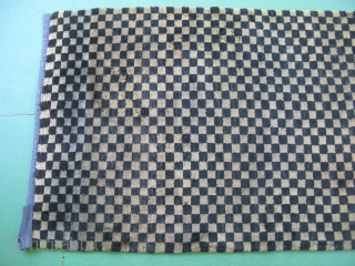 Antique Tibetan checkerboard rug, hand knotted wool, Tibet, late 19th / early 20thC, good pile but with some moth damage resulting in uneven pile and a couple small holes, small stains, dye  ...