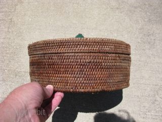 Antique Chinese rattan basket, 19th/20thC, single rod hand coiling with spaced stitches, traditionally this type of basket would have a knob top, but instead, the weaver has used a Ch'ing Dynasty Mandarin  ...