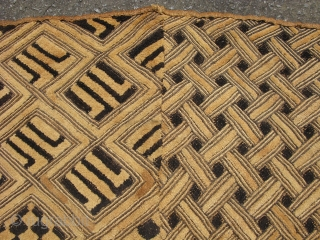 African Kuba raffia cloth, two large squares sewn together and probably used as a waist wrap around dress, hand woven palm fiber, a field of cut-loop pile embroidery and flat stitch embroidery,  ...
