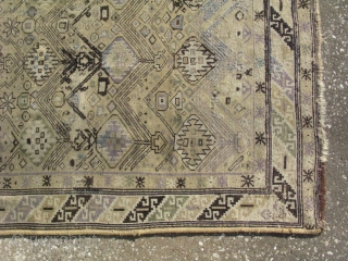 Antique Caucasian rug, hand knotted wool, Caucasus Mountains, Azerbaijan, 19thC, poor condition but pretty, worn flat, wool added in places some knotting and some needle work called Kashmiri, a couple of small  ...