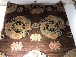 Tibetan rug, size 146*80cm. Brown color , medallion flowers . Good age.