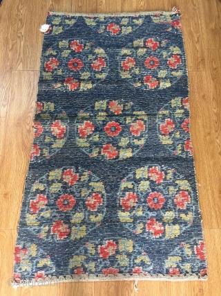 Tibetan rug, size 111*78cm . Flower medallion in blue color.