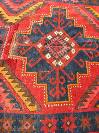 Kirgiz Carpet,Central Asia,  Wool, 53 x 105 inches, In rather rough condition with spots of wear and some incomplete repairs that need to be clipped.  A little work would improve  ...