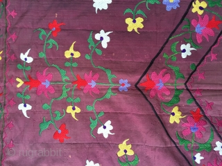 Very pretty antique Lakai suzani from the late  19 c  fresh in.  Finely embroidered silk on a plum silk ground which is soft and not splitting at all.  Was  ...