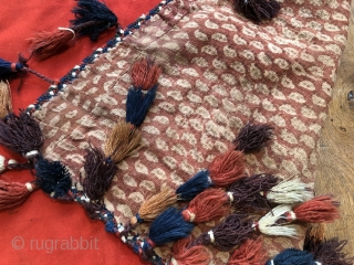 Rare antique Yomud felt asmalyk ca 1900. Original tassels and chat block printed cotton lining. Colours all seem natural few small moth holes and stains otherwise good condition  Size is 105 x 75  ...