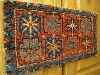 The pile on this Kurdish bag face has such a patina that when seen at certain angles of light makes it appear magnificent. There is a gorgeous deep aubergine.The blueish stars are  ...