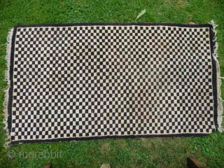 SOLD  Tibetan checkerboard rug, collected in Tibet in the early 20th c. interesting provenance, small damage to two corners otherwise good condition,5ft3in x 2ft11in.